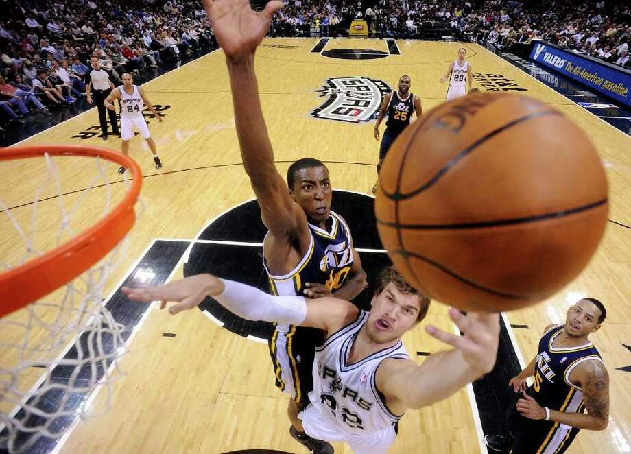 Spurs' Tiago Splitter shoots around  Jazz's Jeremy Evans during first half action Saturday April 9, 2011 at the AT&T Center.  (PHOTO BY EDWARD A. ORNELAS/eaornelas@express-news.net) / SAN ANTONIO EXPRESS-NEWS (NFS)