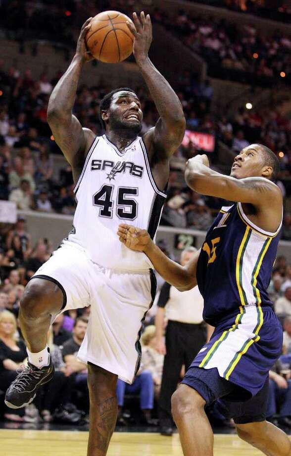 Spurs' DeJuan Blair shoots around Jazz's Derrick Favors during first half action Saturday April 9, 2011 at the AT&T Center.  (PHOTO BY EDWARD A. ORNELAS/eaornelas@express-news.net) / SAN ANTONIO EXPRESS-NEWS (NFS)