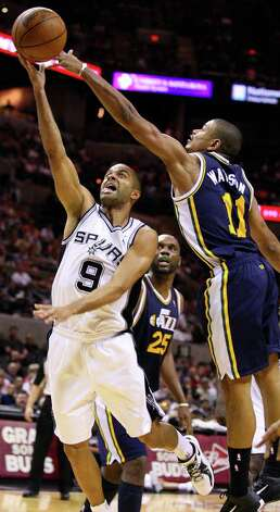 Spurs' Tony Parker shoots around Jazz's Earl Watson during second half action Saturday April 9, 2011 at the AT&T Center. The Spurs won 111-102.  (PHOTO BY EDWARD A. ORNELAS/eaornelas@express-news.net) Photo: EDWARD A. ORNELAS / SAN ANTONIO EXPRESS-NEWS (NFS)