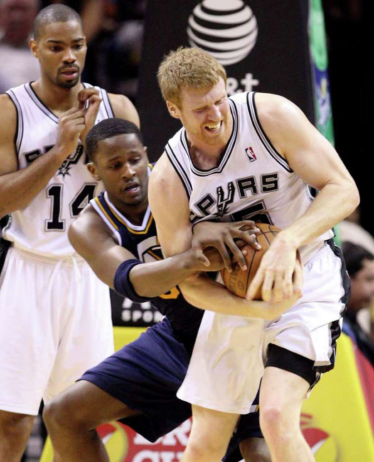Spurs' Matt Bonner and Jazz's C.J. Miles struggle for control of the ball as Spurs' Gary Neal looks on during second half action Saturday April 9, 2011 at the AT&T Center. The Spurs won 111-102. (PHOTO BY EDWARD A. ORNELAS/eaornelas@express-news.net)