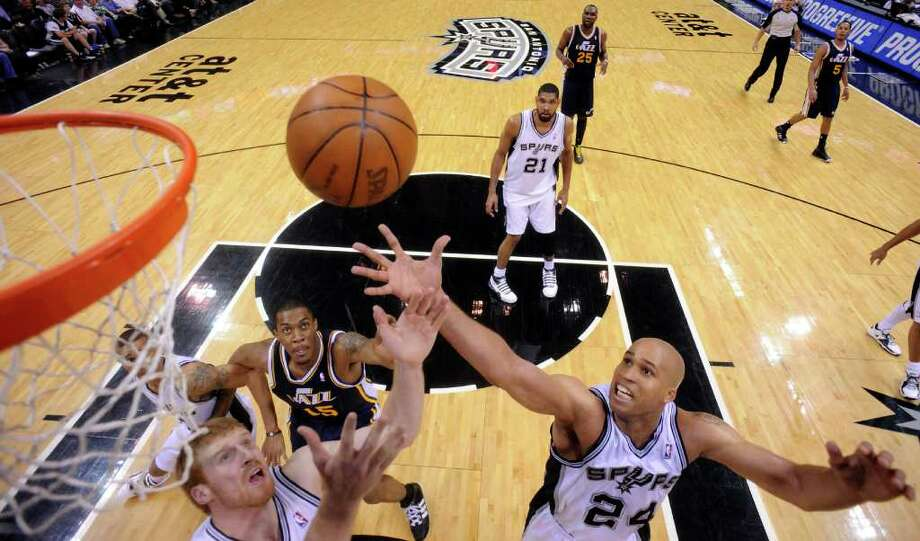 Spurs' Matt Bonner and Spurs' Richard Jefferson grab for a rebound against  Jazz's Derrick Favors during second half action Saturday April 9, 2011 at the AT&T Center. The Spurs won 111-102.  (PHOTO BY EDWARD A. ORNELAS/eaornelas@express-news.net) Photo: EDWARD A. ORNELAS / SAN ANTONIO EXPRESS-NEWS (NFS)