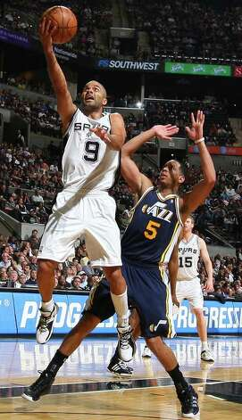 Spurs' Tony Parker shoots around  Jazz's Devin Harris during second half action Saturday April 9, 2011 at the AT&T Center. The Spurs won 111-102.  (PHOTO BY EDWARD A. ORNELAS/eaornelas@express-news.net) / SAN ANTONIO EXPRESS-NEWS (NFS)