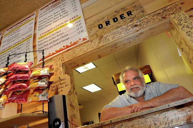 Owner Ron Nicoletta is ready to take orders at Rubbin Butts Bar-B-Q on Tuesday, April 5, 2011, in Schenectady, N.Y. (Cindy Schultz / Times Union) Photo: Cindy Schultz
