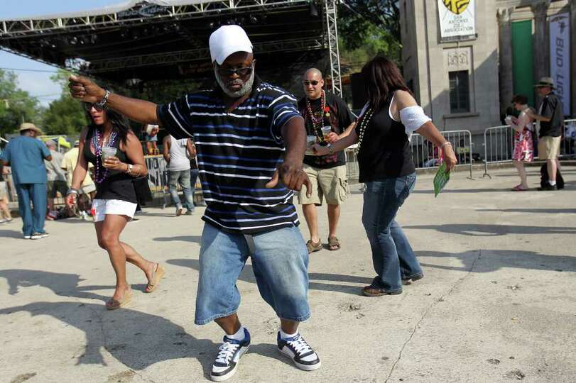 Don P. Barrett from Houston dances to the music at Taste of New Orleans at Sunken Gardens Saturday,