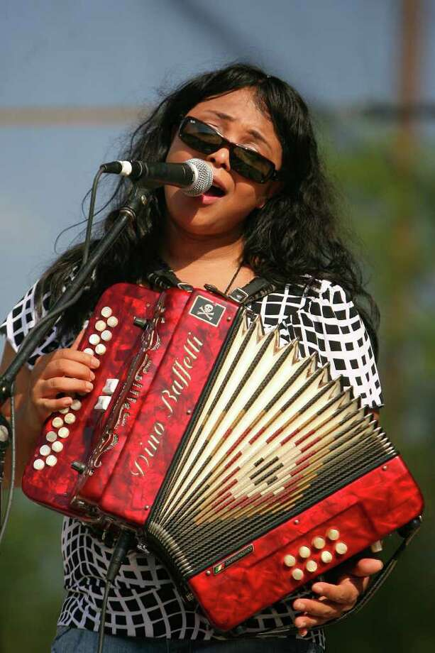 Rosie Ledet performs with her Zydeco Playboys during Taste of New Orleans at Sunken Gardens Saturday, April 9, 2011. Photo: Jennifer Whitney, Jennifer Whitney/Special To The San Antonio Express-News / special to the Express-News