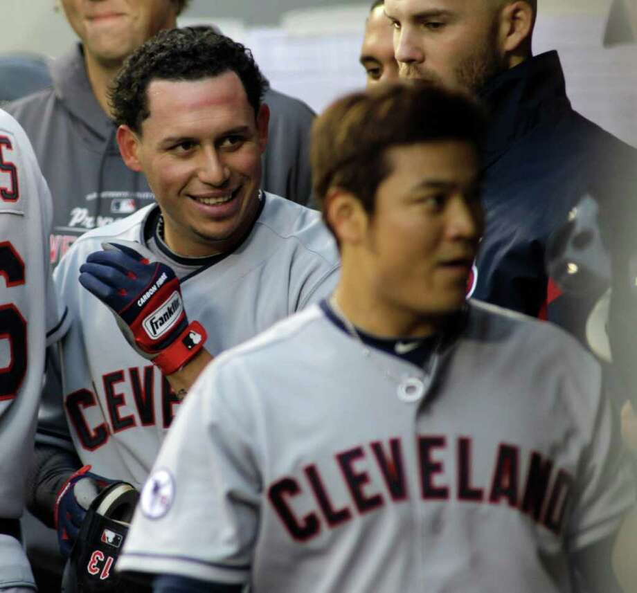 Cleveland Indians' Shin-Soo Choo, right, and Asdrubal Cabrera, left, are greeted in the dugout after they both scored in the fourth inning of a baseball game against the Seattle Mariners, Saturday, April 9, 2011, in Seattle. The Indians beat the Mariners 2-1. Photo: AP