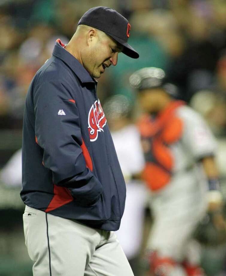Cleveland Indians manager Manny Acta walks back to the dugout after pulling Indians' pitcher Justin Masterson in the seventh inning of a baseball game against the Seattle Mariners, Saturday, April 9, 2011, in Seattle. The Indians beat the Mariners 2-1. Photo: AP