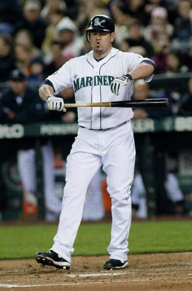 Seattle Mariners designated hitter Jack Cust reacts to a strike in the sixth inning of a baseball ga