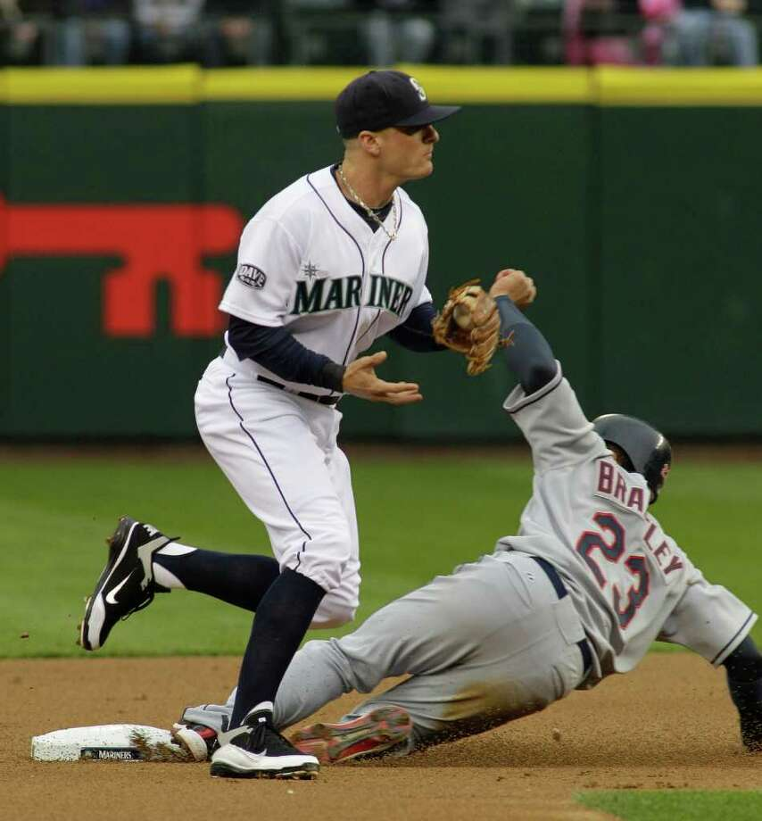 Cleveland Indians' Michael Brantley is forced at second by Seattle Mariners shortstop Brendan Ryan in the first inning of a baseball game, Saturday, April 9, 2011, in Seattle. Asdrubal Cabrera was out at first. Photo: AP