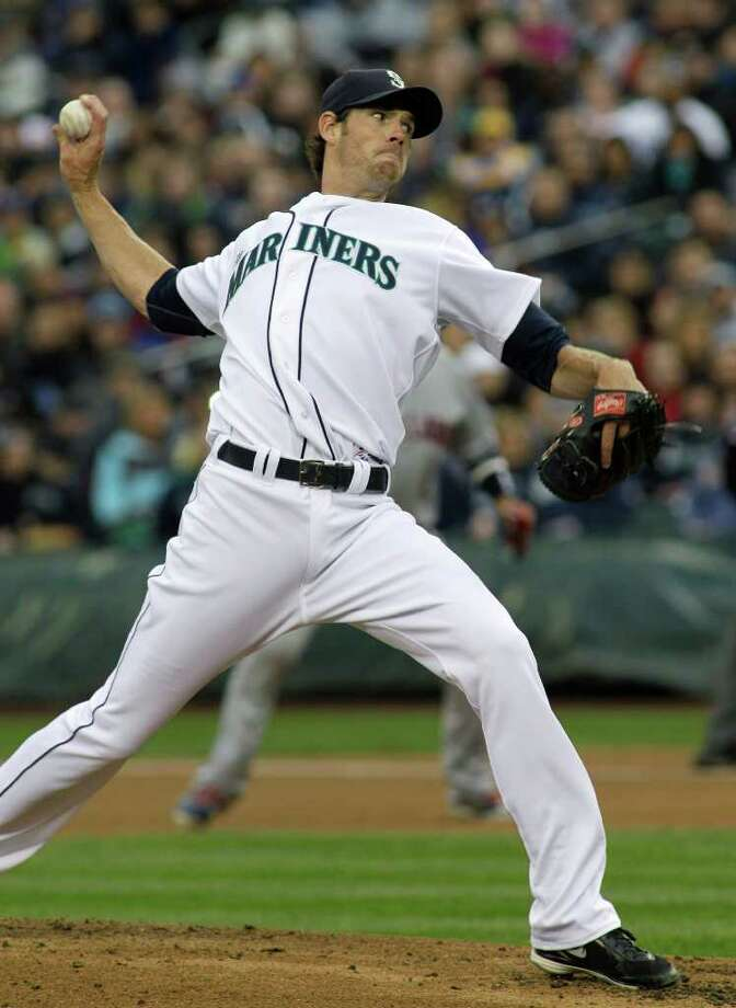 Seattle Mariners starting pitcher Doug Fister throws in the second inning of a baseball game against the Cleveland Indians, Saturday, April 9, 2011, in Seattle. Photo: AP