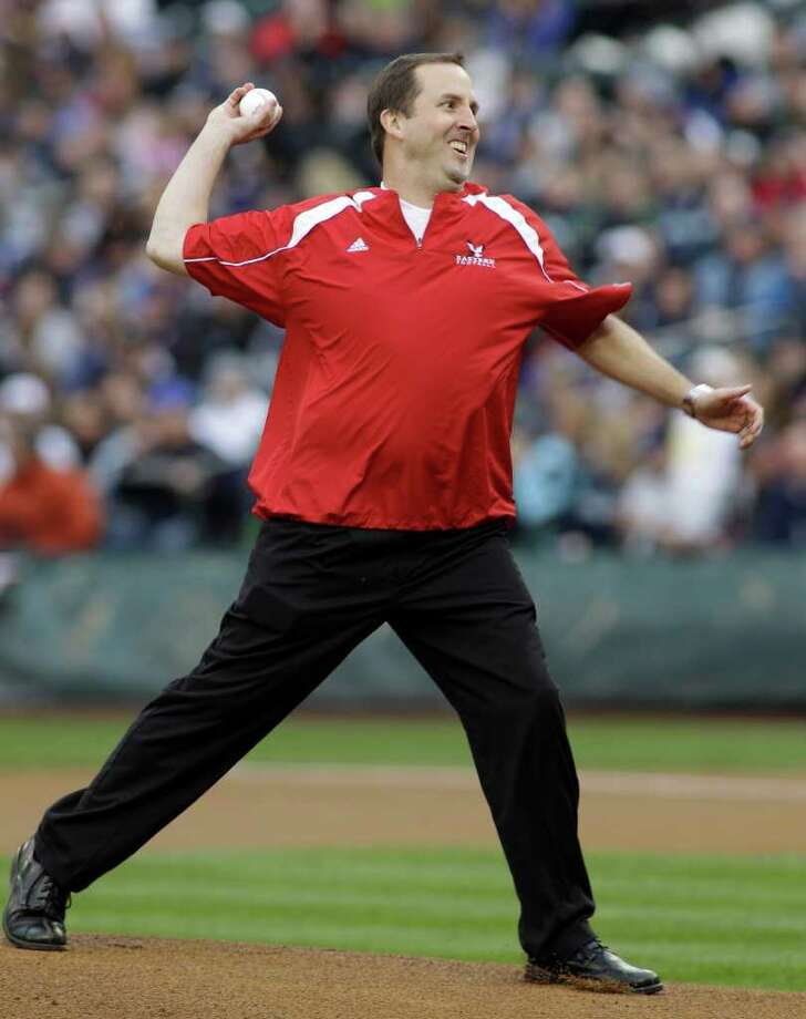 Eastern Washington University head football coach Beau Baldwin throws out the ceremonial first pitch before a baseball game between the Cleveland Indians and the Seattle Mariners, Saturday, April 9, 2011, in Seattle. Photo: AP