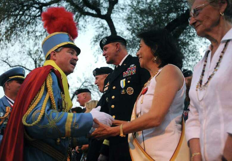 King Antonio LXXXIX Bill Mitchell greets people after his public investiture in Alamo Plaza on April