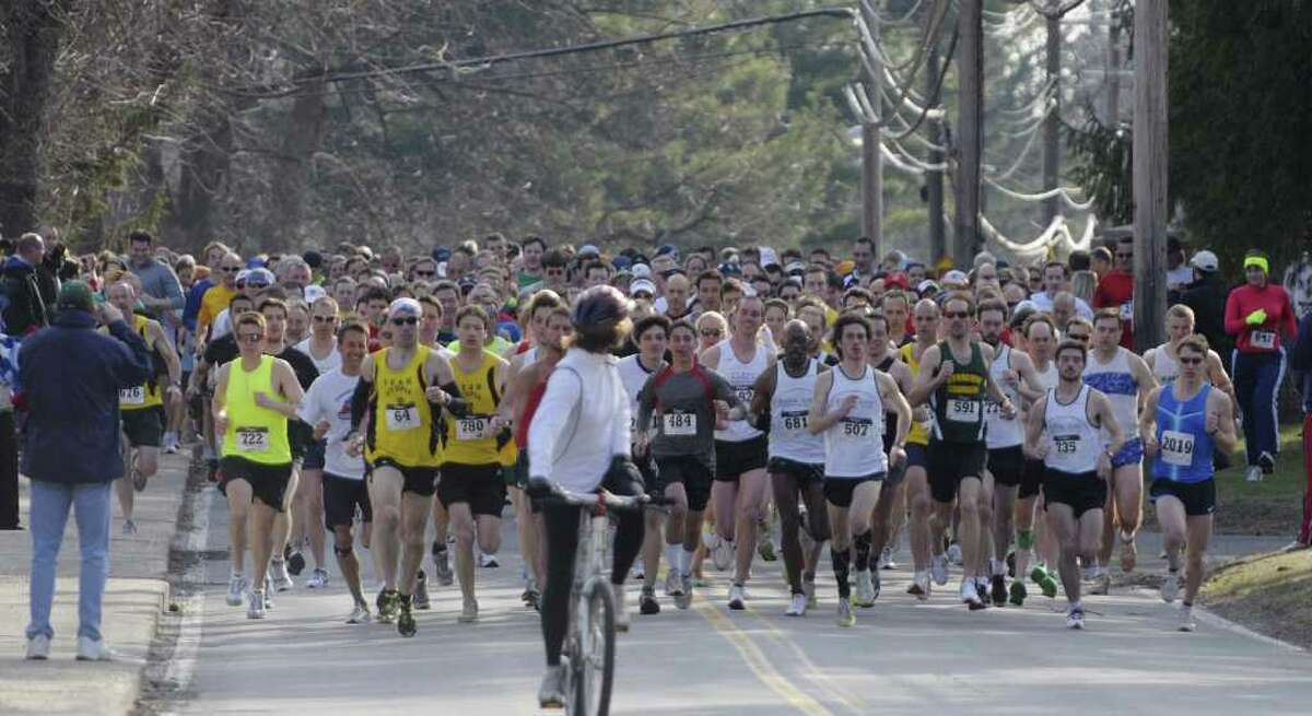 Runners head down Kenwood Avenue just after the start of the annual Delmar Dash on Sunday morning, April 10, 2011 in Delmar, NY. This is the twenty third year for the event billed as a family fitness 5 mile run geared towards adults and kids. (Paul Buckowski / Times Union)