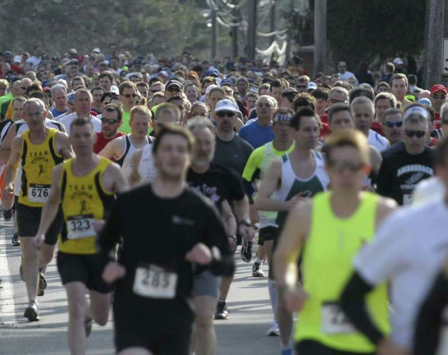 Runners head down Kenwood Avenue during the annual Delmar Dash on Sunday morning, April 10, 2011 in Delmar, NY.  This is the twenty third year for the event billed as a family fitness 5 mile run geared towards adults and kids.  (Paul Buckowski / Times Union) Photo: Paul Buckowski / 00012685A