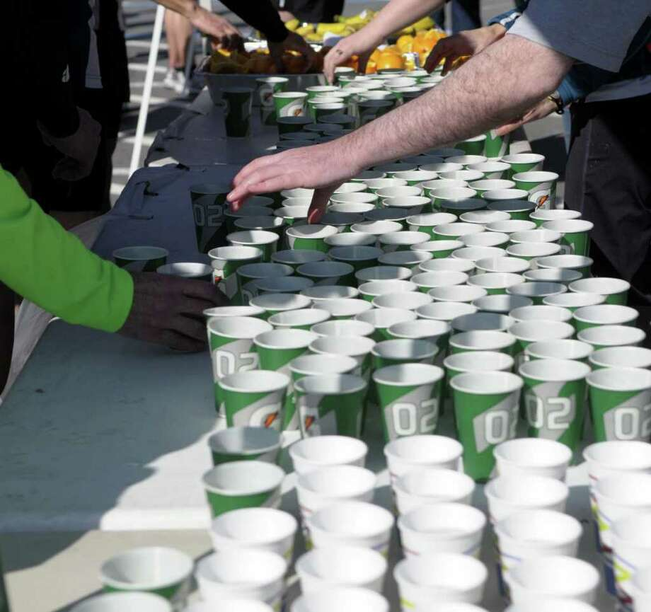 Cups of water were available for runners following the race during the annual Delmar Dash on Sunday morning, April 10, 2011 in Delmar, NY.  This is the twenty third year for the event billed as a family fitness 5 mile run geared towards adults and kids.  (Paul Buckowski / Times Union) Photo: Paul Buckowski / 00012685A