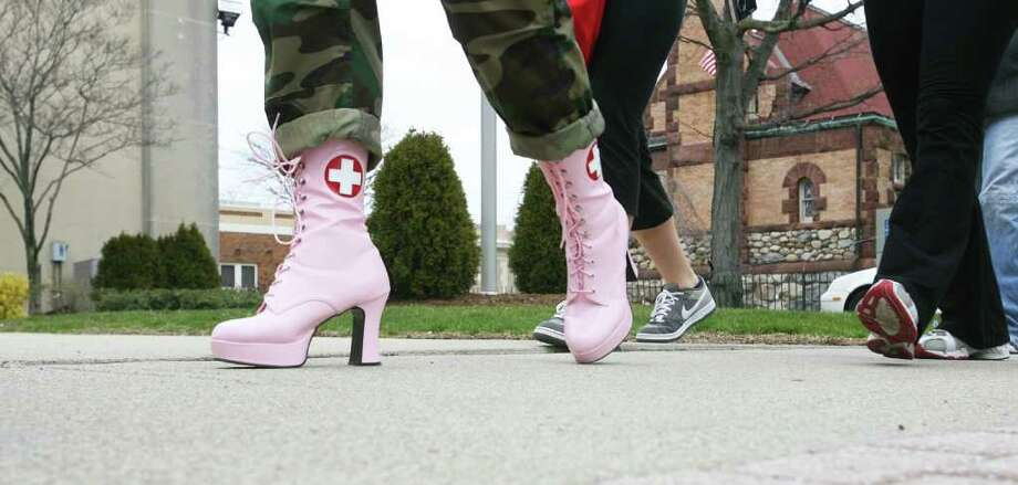 "Volunteers walk in the  5th Annual ""Walk a Mile in Her Shoes"" event, sponsored by The Milford Rape Crisis Center, in Milford on Sunday, April 10, 2011. Photo: B.K. Angeletti / Connecticut Post"