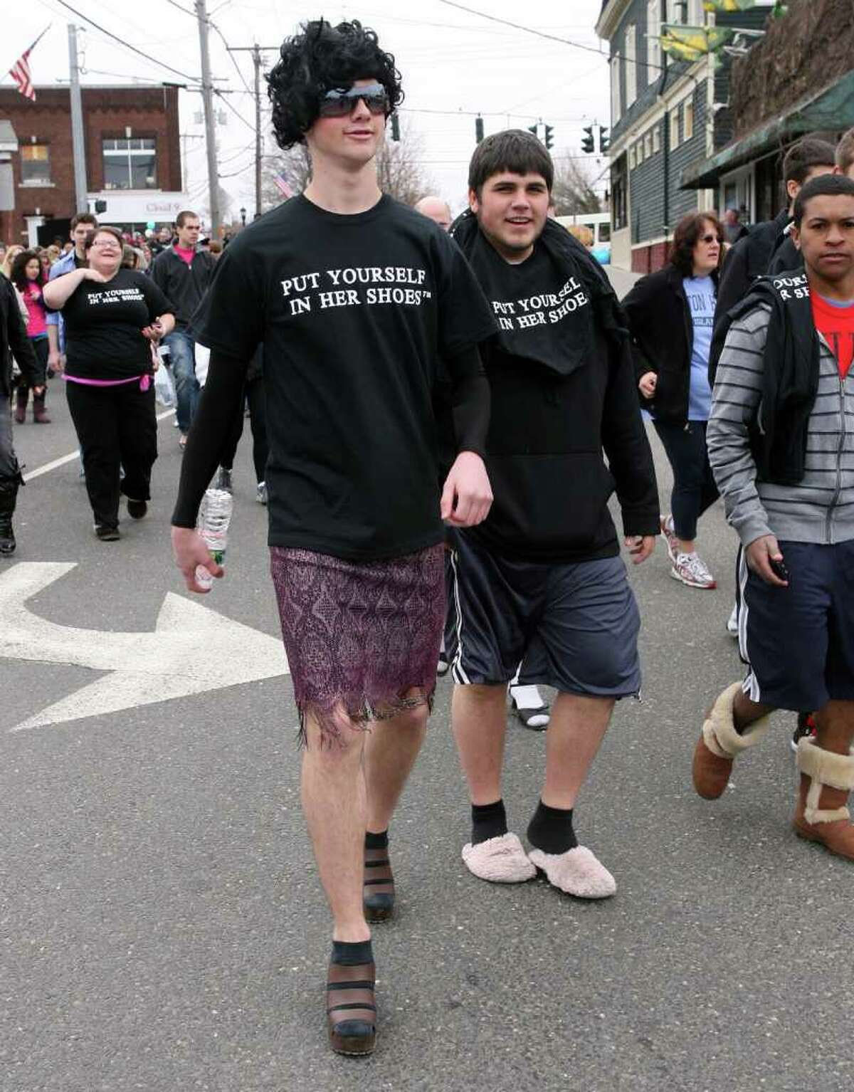 Tim Carew, 16, left, of Platt Tech, walks in the 5th Annual
