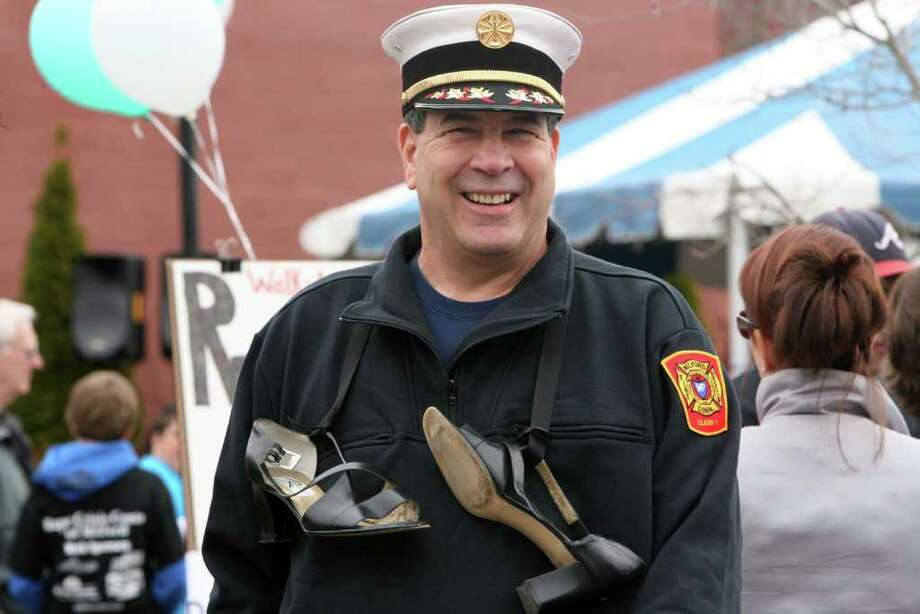 """Fire Chief Lou LaVecchia prepares to walk in the  5th Annual """"Walk a Mile in Her Shoes"""" event, sponsored by The Milford Rape Crisis Center, in Milford on Sunday, April 10, 2011. Photo: B.K. Angeletti / Connecticut Post"""