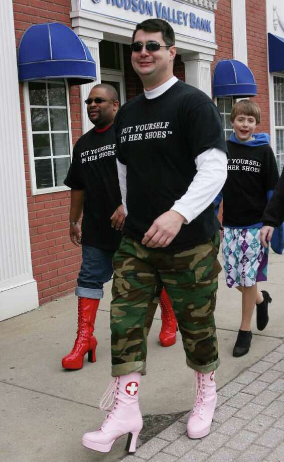 """Volunteers, from left, James Pollard, of Hamden, Kevin Holster, of New Haven, and Raymond Paskiewicz, 12, of Milford, walk in the  5th Annual """"Walk a Mile in Her Shoes"""" event, sponsored by The Milford Rape Crisis Center, in Milford on Sunday, April 10, 2011. Photo: B.K. Angeletti / Connecticut Post"""