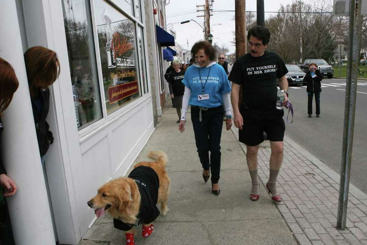 Peggy and Tom Pisano walk with their dog, Lily, in the 5th Annual