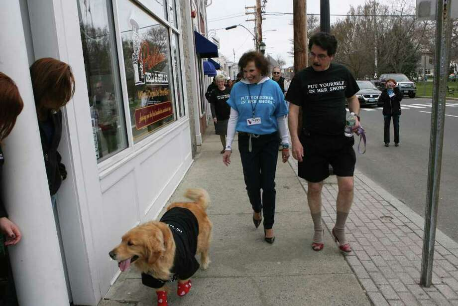 "Peggy and Tom Pisano walk with their dog, Lily, in the  5th Annual ""Walk a Mile in Her Shoes"" event, sponsored by The Milford Rape Crisis Center, in Milford on Sunday, April 10, 2011. Peggy Pisano is Executive Director of the center. Photo: B.K. Angeletti / Connecticut Post"