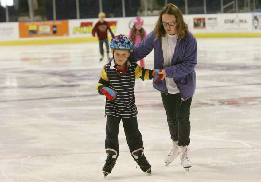 Brittany Marson, 12, of Fairfield, helps her brother, Logan, 6, skate at the St. Baldricks celebration at Webster Bank Arena in Bridgeport on Sunday, April 11, 2010. The event raises funds for children with cancer.