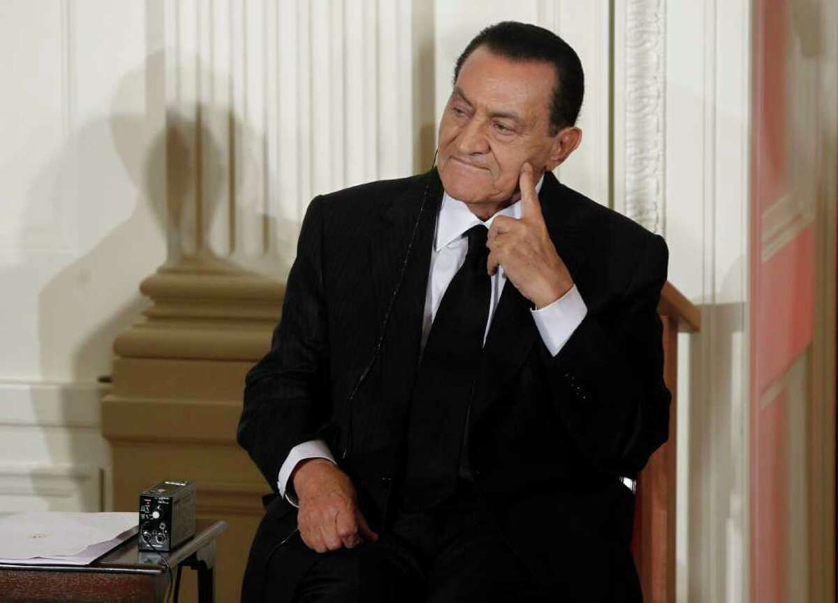 FILE - In this Wednesday, Sept. 1, 2010 file photo, Egypt's President Hosni Mubarak listens as Israel's Prime Minister Benjamin Nethanyahu, unseen, speaks in the East Room of the White House in Washington. Ex-Egyptian President Hosni Mubarak denied abuse of authority in his first speech since ouster Sunday. (AP Photo/Charles Dharapak, File)