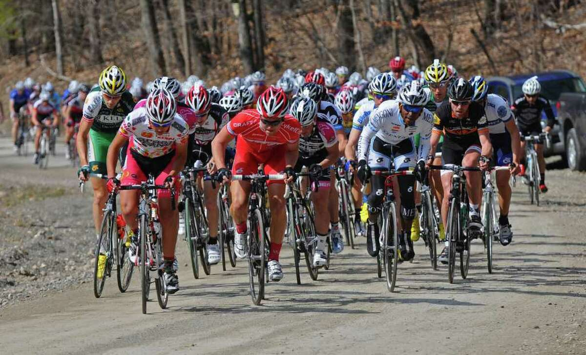 Professional riders work hard to ascend Juniper Swamp Road, a dirt road, during the Tour of the Battenkill 2011 bike race, on Sunday April 10, 2011 in Shushan, NY. (Philip Kamrass/ Times Union )
