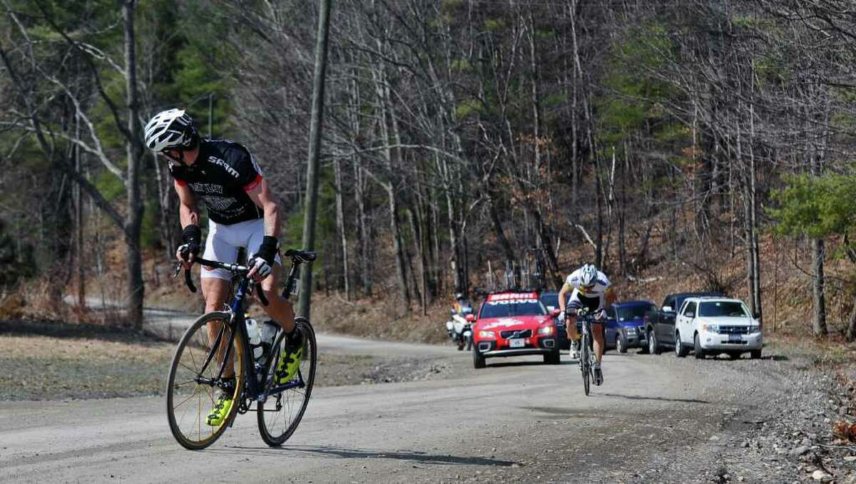 The early leader battles to stay in first as professional riders work hard to ascend Juniper Swamp Road, a dirt road, during the Tour of the Battenkill 2011 bike race, on Sunday April 10, 2011 in Shushan, NY. (Philip Kamrass/ Times Union )