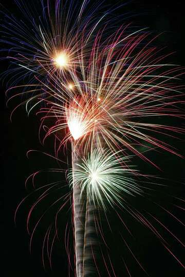 FOR METRO - Fireworks explode during the Fiesta & Fireworks at Fort Sam Houston Sunday April 10, 201