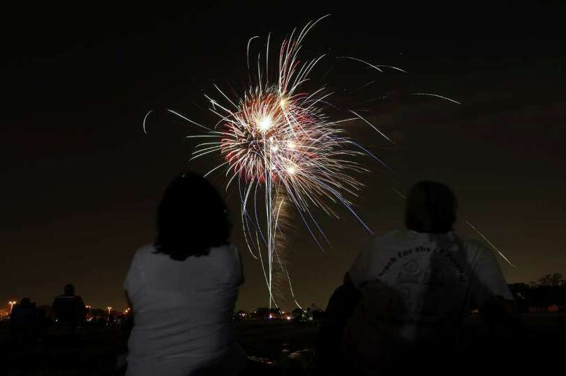 FOR METRO - A couple watches the fireworks during the Fiesta & Fireworks at Fort Sam Houston Sunday