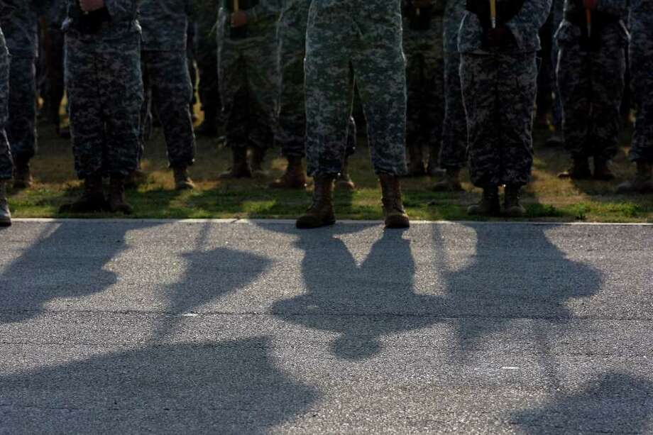 FOR METRO - A soldier cast a shadow while in formation during the Fiesta & Fireworks at Fort Sam Houston Sunday April 10, 2011. (PHOTO BY EDWARD A. ORNELAS/eaornelas@express-news.net) Photo: EDWARD A. ORNELAS, Edward A. Ornelas/Express-News / SAN ANTONIO EXPRESS-NEWS (NFS)