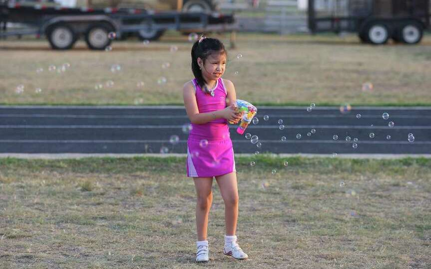 FOR METRO - Brianna Valdez plays with bubbles during the Fiesta & Fireworks at Fort Sam Houston Sund