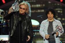 Daryl Hall, left, and John Oates accept the Music Icon Award at the 2011 TV Land Awards on Sunday, April 10, 2011, in New York.