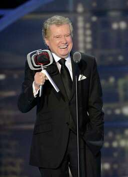 "Regis Philbin accepts the ""Legend Award"" on stage during the 2011 TV Land Awards show on Sunday, April 10, 2011 in New York. Photo: AP"