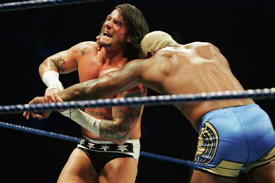 SYDNEY, AUSTRALIA - JUNE 15:  CM Punk wrestles Shelton Benjamin during WWE Smackdown at Acer Arena on June 15, 2008 in Sydney, Australia.  (Photo by Gaye Gerard/Getty Images) *** Local Caption *** Shelton Benjamin;CM Punk Photo: Gaye Gerard, Getty Images / 2008 Getty Images