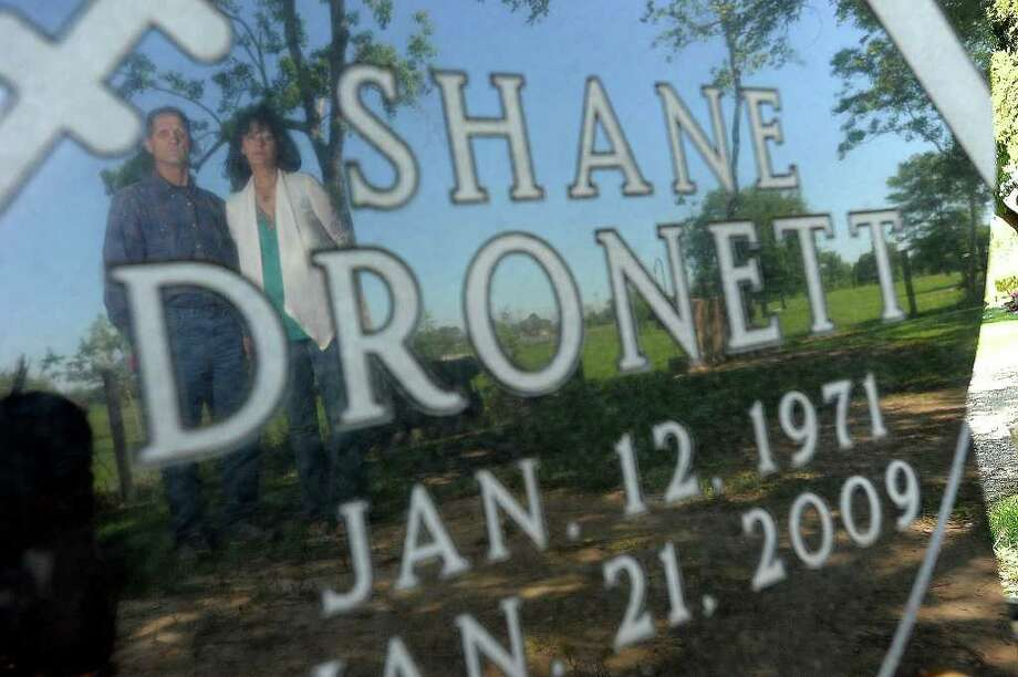 Shane Dronett's mother, Candace Henry, and his stepfather, James Breeden, stand at the late football player's grave. Guiseppe Barranco/The Enterprise Photo: Guiseppe Barranco / Beaumont