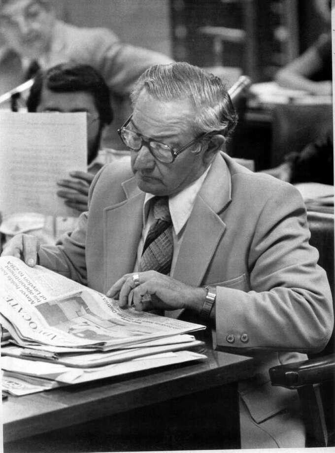 Sept. 1979: Representative John Boccuzzi reads The Advocate. Photo: File Photo / Stamford Advocate File Photo