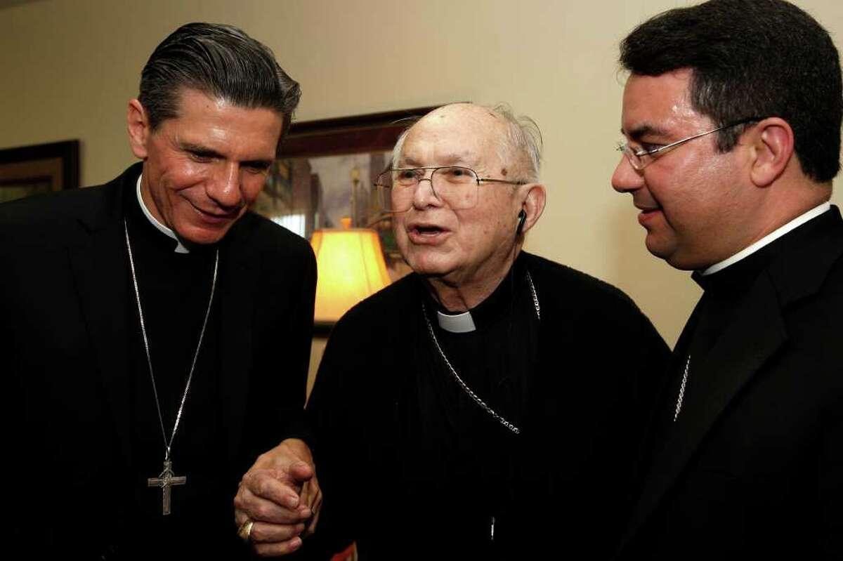 METRO -- The Most Rev. Archbishop Gustavo Garcia-Siller, left, and Bishop Oscar Cantu, right, listens as Archbishop Emeritus Patrick Flores, talks with them at Padua Place, Thursday, Oct. 14, 2010. JERRY LARA/glara@express-news.net