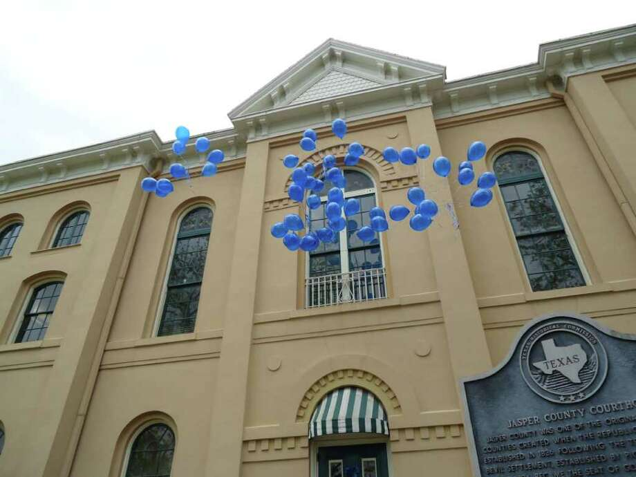 57 blue balloons soared over head representing child abuse victims in Jasper County Photo: Jodie Warner