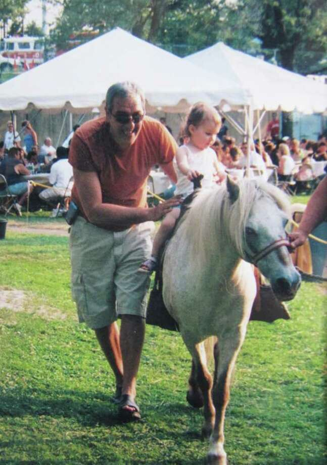 Festival Italiano founder Michael Rea is seen here assisting his granddaughter Serena with a pony ride. It was announced last week that Festival Italiano, now run by a Norwalk woman, will not be taking place this year, in part because volunteerism isn't what it used to be. Photo: Contributed Photo / Westport News