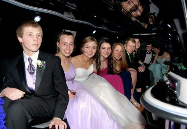 AnthonyPeplau, Tyler Kendall, Sophie Ponchak, Holly Barra, Julie Newton, David Luchs, Isabelle Herde, Chris Dudley, and Tricia Ostendorf arrive via limousine at the Italian Center in Stamford for the New Canaan High School Junior Prom last Friday night. Photo: Jeanna Petersen Shepard / New Canaan News