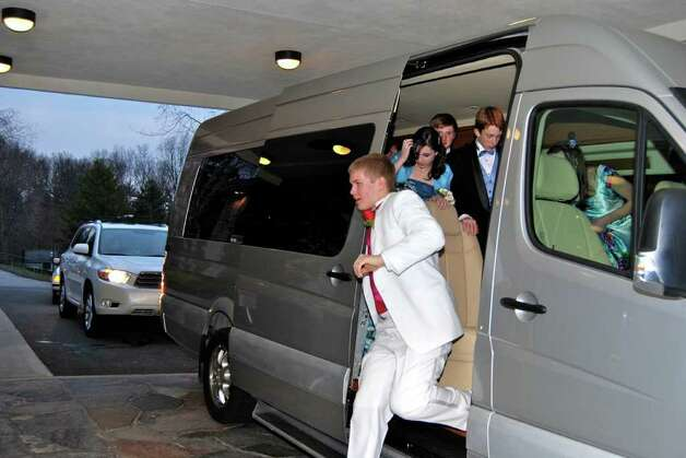 Mass transportation:  Nicholas White steps down out of the van. Photo: Jeanna Petersen Shepard / New Canaan News