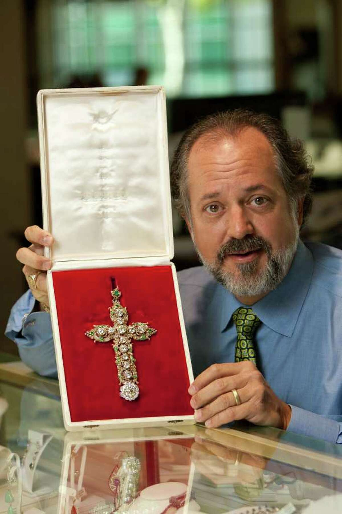 Alan Perry, owner of jewelry store Perry's Emporium, displays the papal jewelry he will be selling for a customer in Wilmington, NC, Wednesday, April 6, 2011. The jewelry belonged to Pope Pius XII and then Paul VI who donated it to the United Nations to be auctioned as a fundraiser in 1965. The current owner of the jewelry lives in Wilmington. (AP Photo/Logan Wallace)
