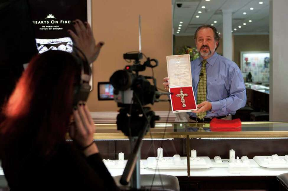 Alan Perry, owner of jewelry store Perry's Emporium, makes a new commercial featuring the papal jewelry he will be selling for a customer in Wilmington, NC, Wednesday, April 6, 2011. The jewelry belonged to Pope Pius XII and then Paul VI who donated it to the United Nations to be auctioned as a fundraiser in 1965. The current owner of the jewelry lives in Wilmington. (AP Photo/Logan Wallace)