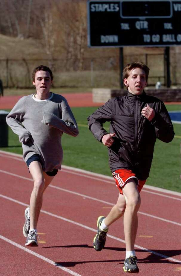 Spring sports preview at Staples High School in Westport, Conn. on Tuesday March 29, 2011. Captain Jack Roache, left, and Mik Kulis circle the track at boys track practice. Photo: Christian Abraham / Connecticut Post