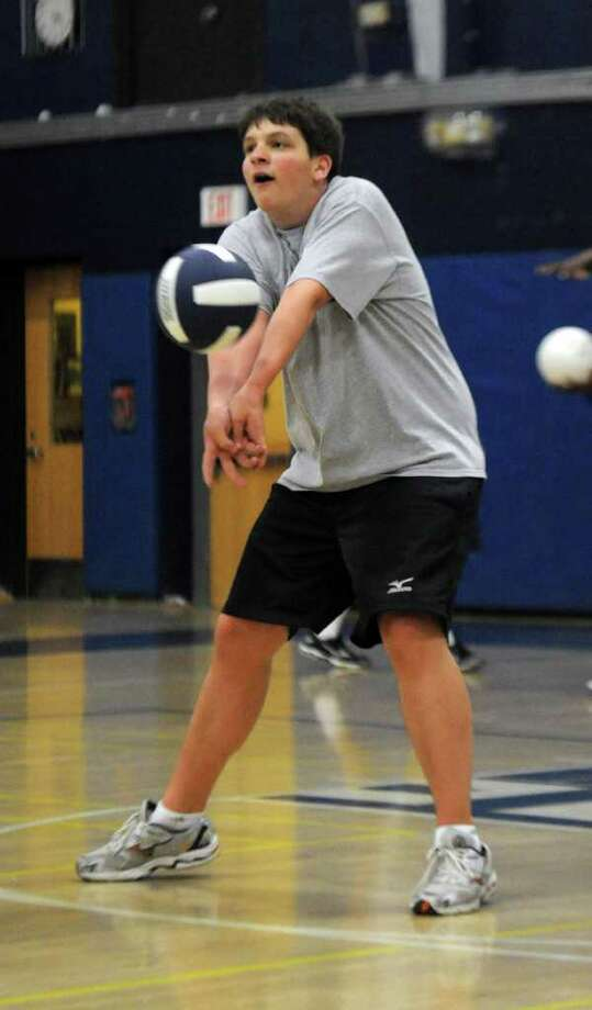Andrew Fishman participates in practice for the boys volleyball team at Staples High School on Tuesday, March 29, 2011. Photo: Lindsay Niegelberg / Connecticut Post