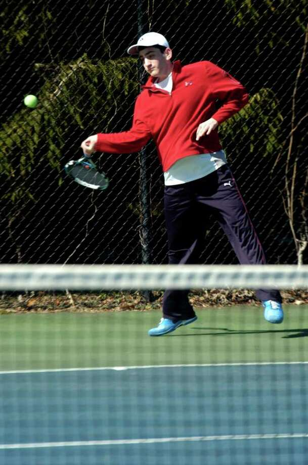 Justin Kleiner plays during tennis practice at Staples High School on Tuesday, March 29, 2011. Photo: Lindsay Niegelberg / Connecticut Post