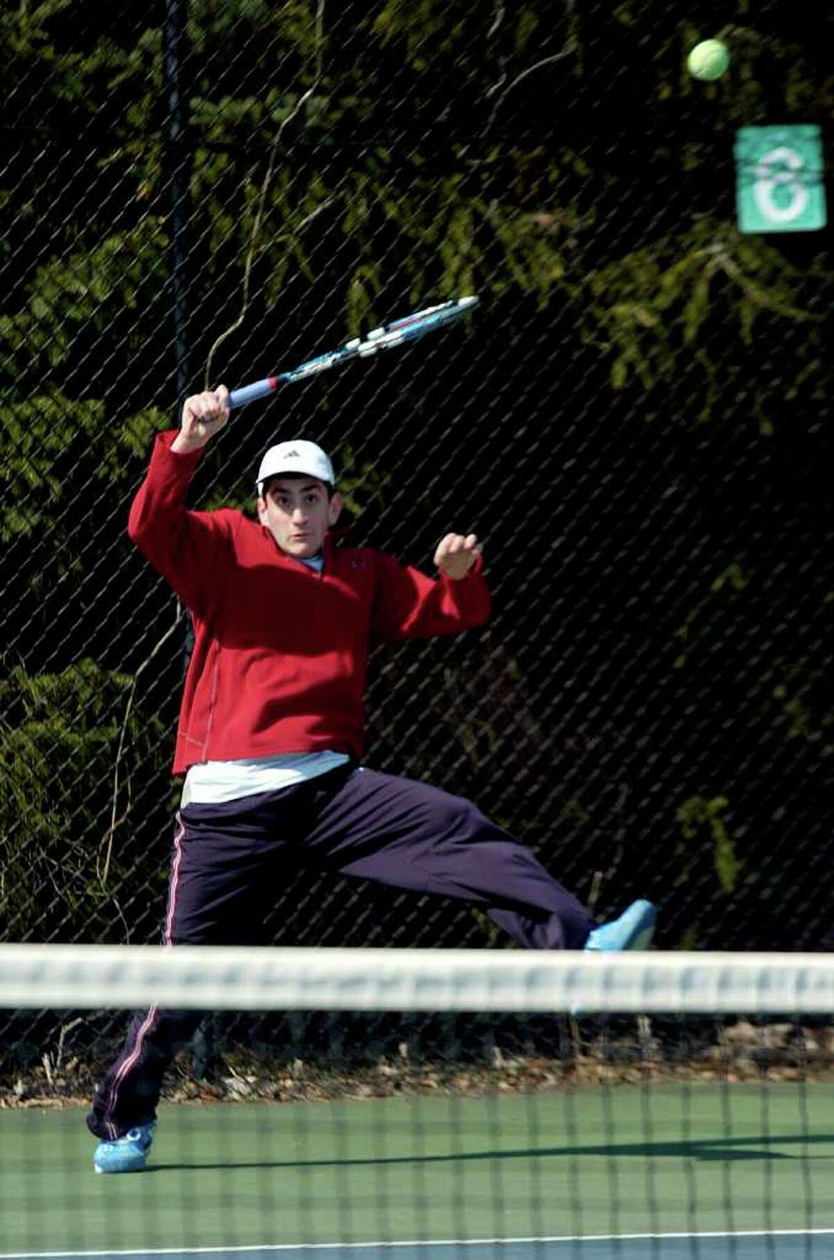 Justin Kleiner plays during tennis practice at Staples High School on Tuesday, March 29, 2011.