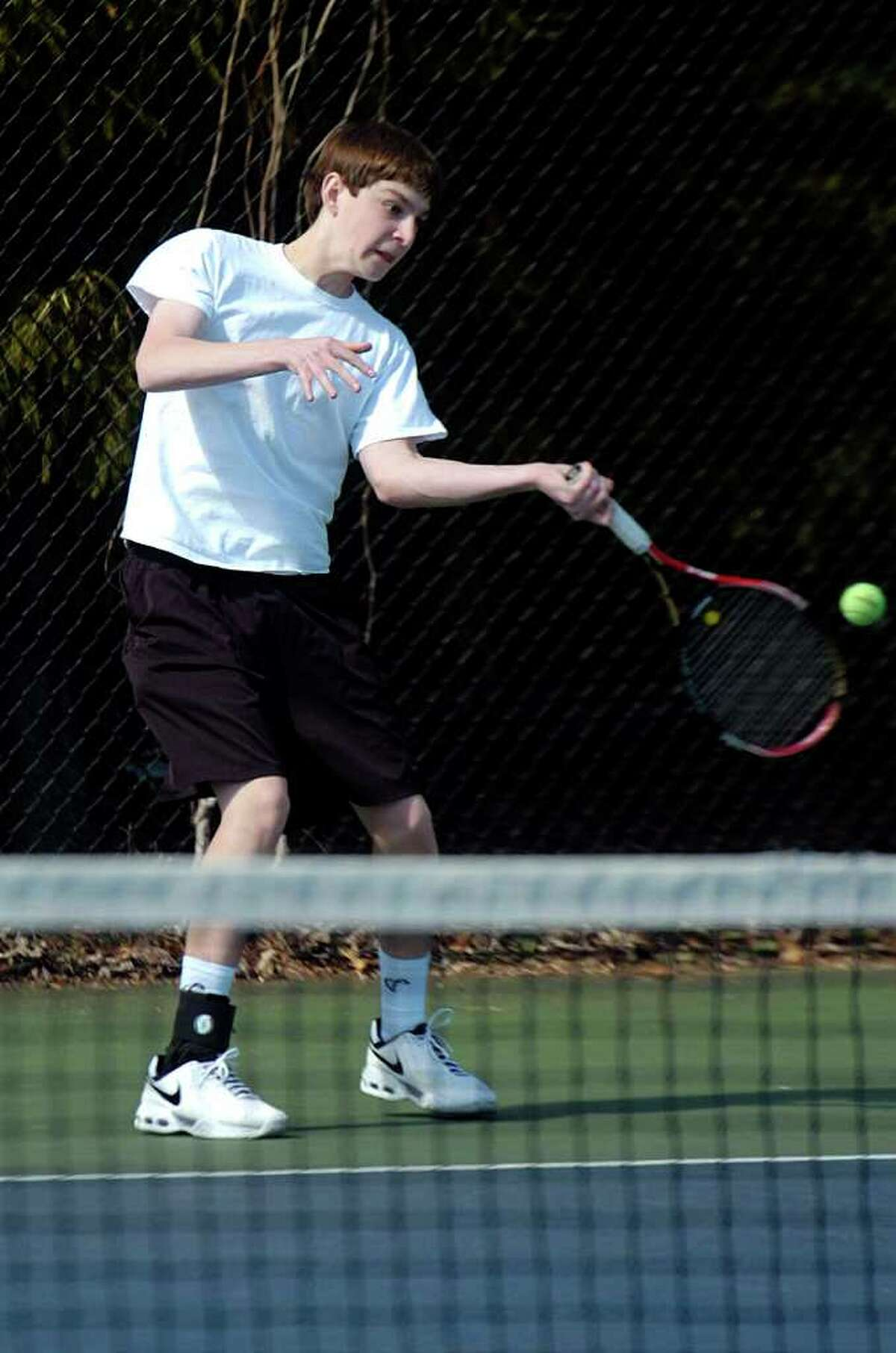Grahm Hyman plays during tennis practice at Staples High School on Tuesday, March 29, 2011.